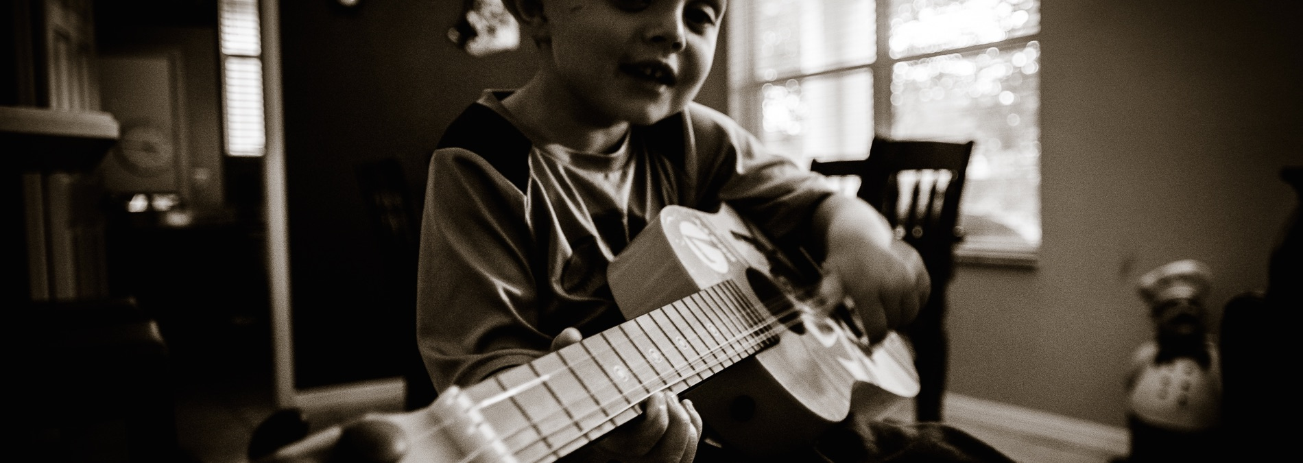 Our Little Musician – Candid Portraits