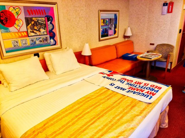 Carnival Liberty Balcony Stateroom - King-Size Bed