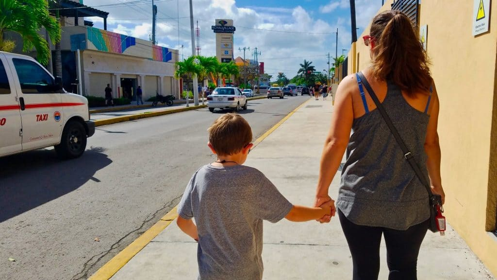 Royal Caribbean Cozumel Cruise - My Wife and Son Walking Outside the Port