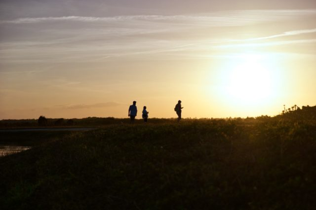 Orlando Wetlands Park Review - Family Walking at Sunset
