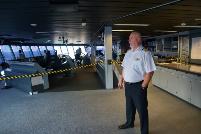 Behind the Scenes Ship Tour - The captain of the Royal Caribbean Independence of the Seas Captain Theo watches our course.
