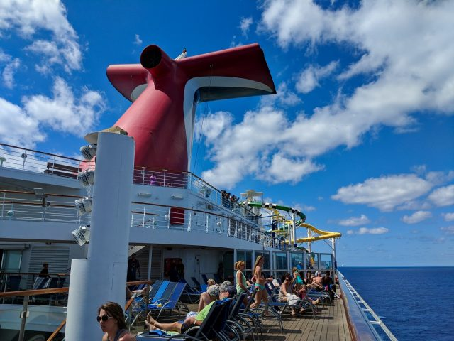Carnival Sunshine whale tail on a partly cloudy day